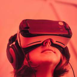 Woman wearing VR headset with red overlay