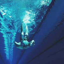 Man diving underwater in swimming pool