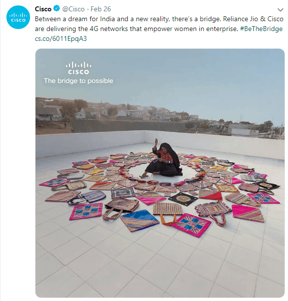 Twitter photo of a woman surrounded by bags