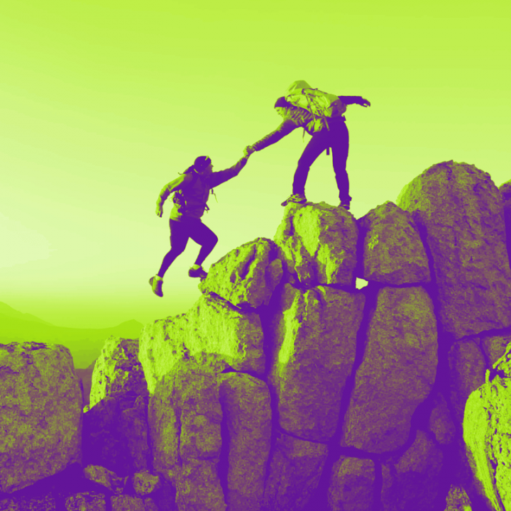 Green and purple photo of climbers helping each other up mountain